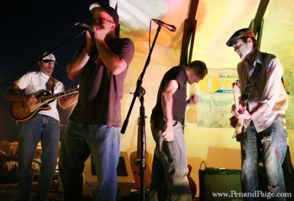 Rock and folk band The Peach Pickers with guest harmonica player Dan Page jam during the award show.