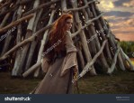 stock-photo-outdoors-portrait-of-beautiful-furious-scandinavian-warrior-ginger-woman-in-a-traditional-clothes-495589228