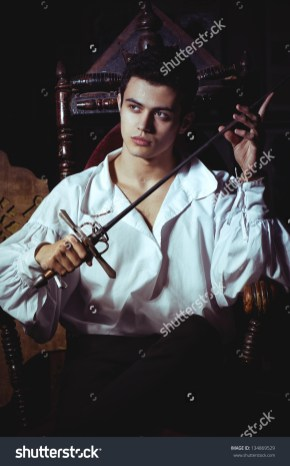 stock-photo-portrait-of-a-romantic-man-with-a-sword-134869529
