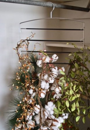 Try these 5 holiday storage hacks to organize your Christmas decor. Hang wreaths, flags, and garland.
