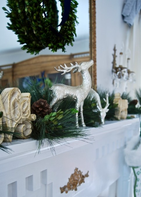 My Southern Christmas Mantle with long-leaf pine and boxwood garland and reindeer