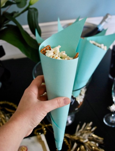 Make a sweet and salty popcorn mix using SkinnyPop's naturally sweet popcorn for a great party snack.