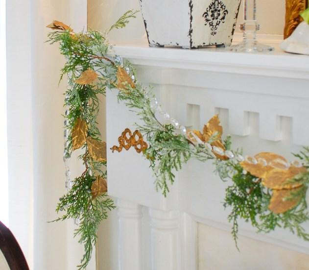 Poinsettia, juniper, paper whites, velvet ribbon, and gold accents mingle merrily in my green & gold Christmas living room!