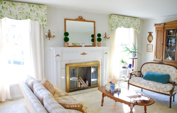 Gingham and chintz harmonize in this traditional living room for a bright and airy space that is full of Chinoiserie details and Southern charm.