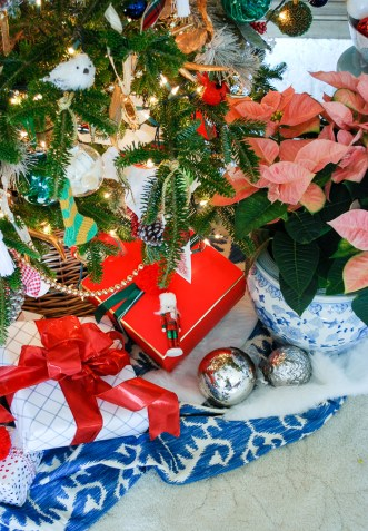 Pretty presents tied up with bows under a preppy & plaid Christmas tree