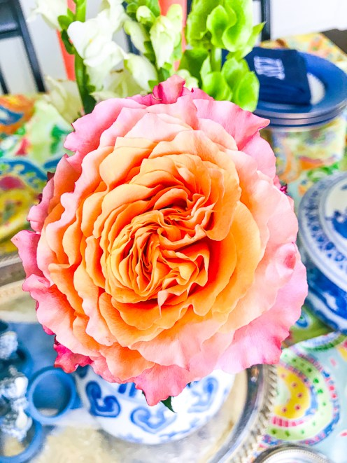 pink and orange rose as floral centerpiece on this summer table
