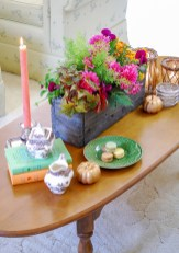 Decorate coffee table for autumn with a fall dish garden