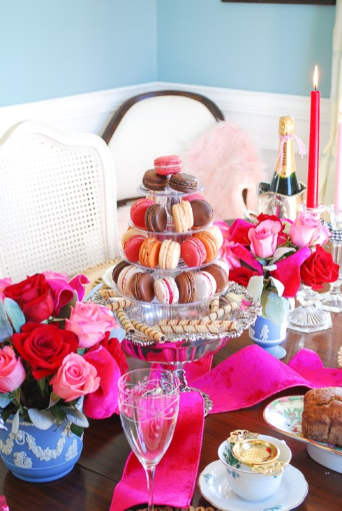 Pink, cream, brown, and orange colored macarons nestled on tower for Valentine's Day tea party