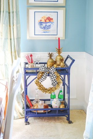 Navy rattan bar cart before plate wall install