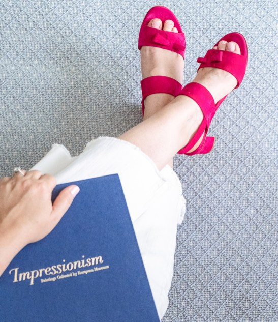 A pair of sassy pink sandals from Sarah Flint against blue rug