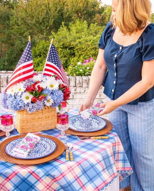 Katherine places napkin on 4th of July table