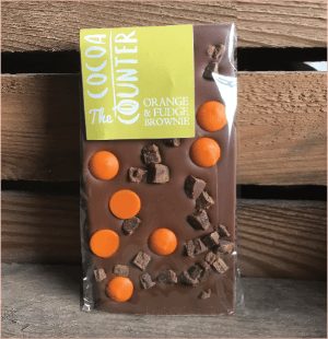 Milk chocolate bar with orange buttons and fudge