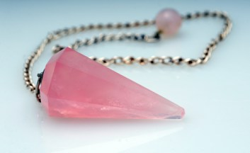 A healing rose quartz new age pendulim