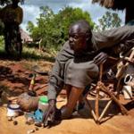 brujo keniano, John Dimo