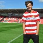 A sus 22 años, el cantante de la 'boyband' adquiere al equipo de la tercera liga inglesa.