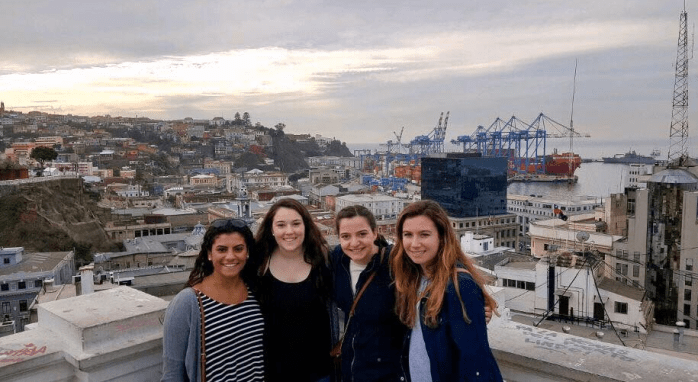 Caption: Left to right: Brianna Camara, Kathryn Limerick, Ashley Lindsey and Allie Either stand on a balcony overlooking Chile.