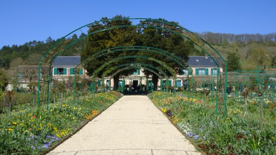 Grand arch of the main entrance to Monet's home, by Penne Cole