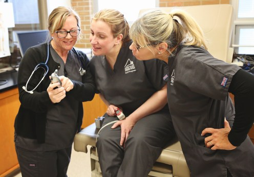 Tammy Calpin (left) instructs two students in the Medical Assisting Technology program (right).