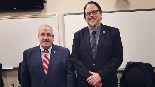 Detective Kevin Gaudlip (left) of the Richland Township PD with Dr. Robert Clark (right) of Pennsylvania Highlands Community College.