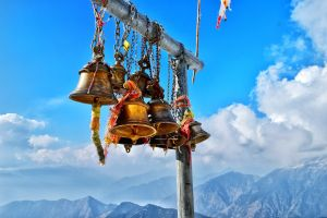 Bells with Himalayas behind at Tunganath temple in Chopta, Uttrakhand