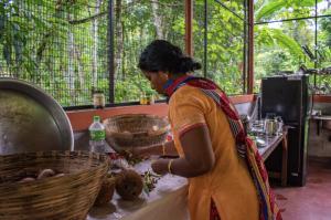 Nisha helps in cooking tasty Kerala food in Poornodaya