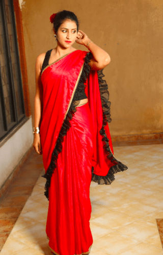 Posing in a red saree