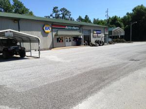 Oil and chip drive and parking area for Honey's Service Station & Tire Center in Ullin, IL | Penninger Asphalt Paving, Inc. – Southern Illinois Commercial & Residential Asphalt & Oil and Chip Paving