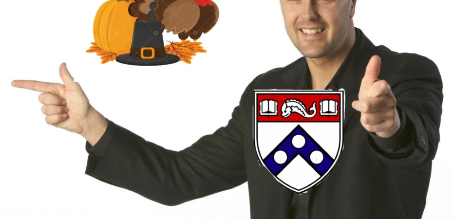 Man pointing finger guns, with a Thanksgiving turkey/pilgrim hat/pumpkin, and a Penn logo