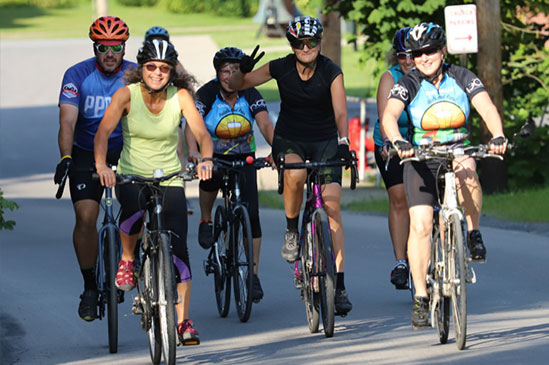 Bicycle Riders on Mill Street