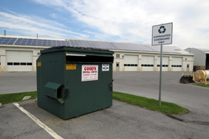 Picture of dumpster where residents can place corregated cardboard for recycling.