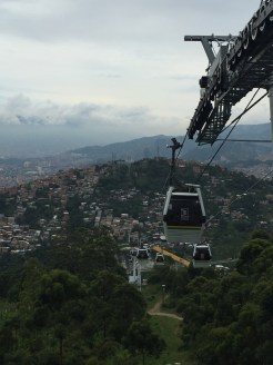 Cable cars connecting communities to the city.