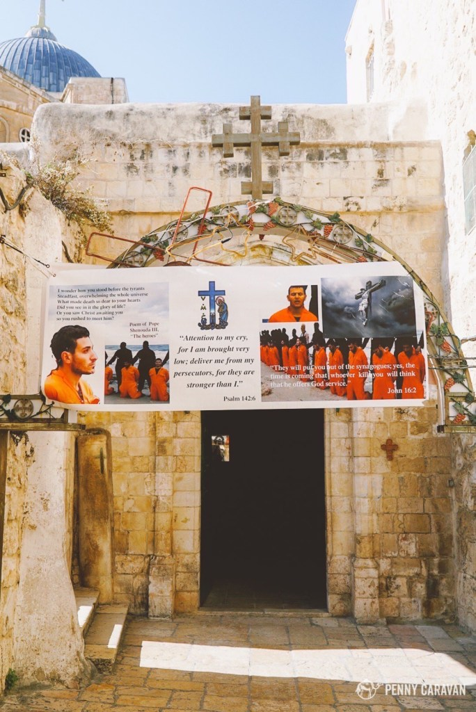 A banner at the ninth station honors the Coptic Christians who were recently beheaded for their faith by the Islamic state.