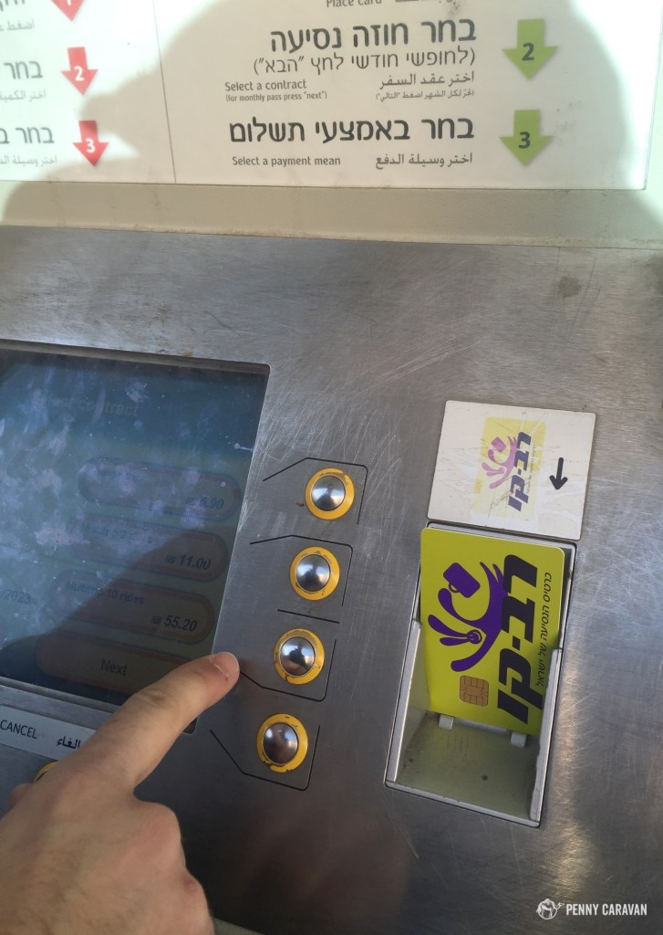 Using the kiosk at the lightrail station to refill our Rav Kav card.
