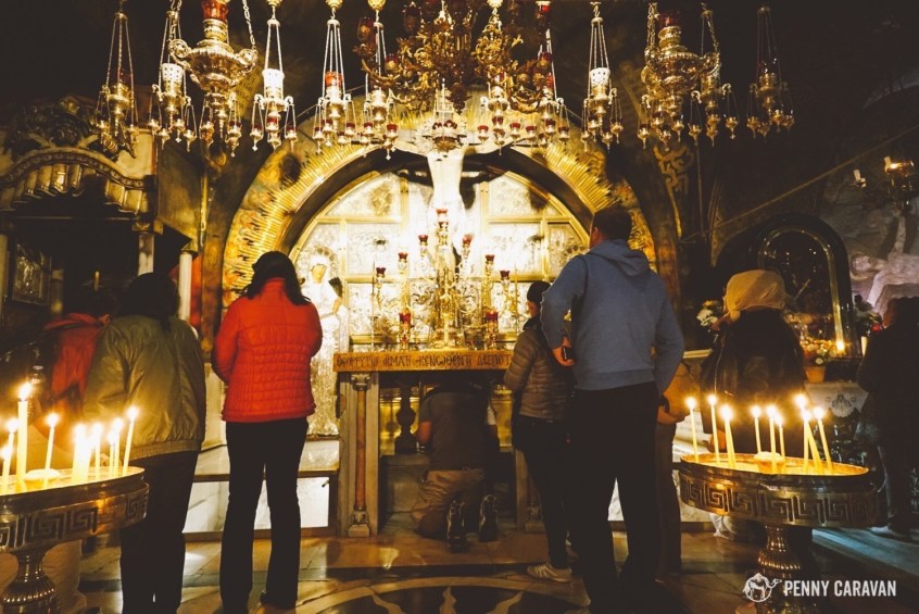 Pilgrims may kneel under the shrine to touch the rock of Calvary.