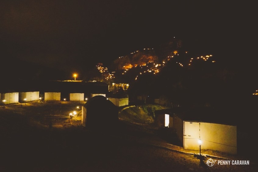 Same view at night, when the hill is lit up.