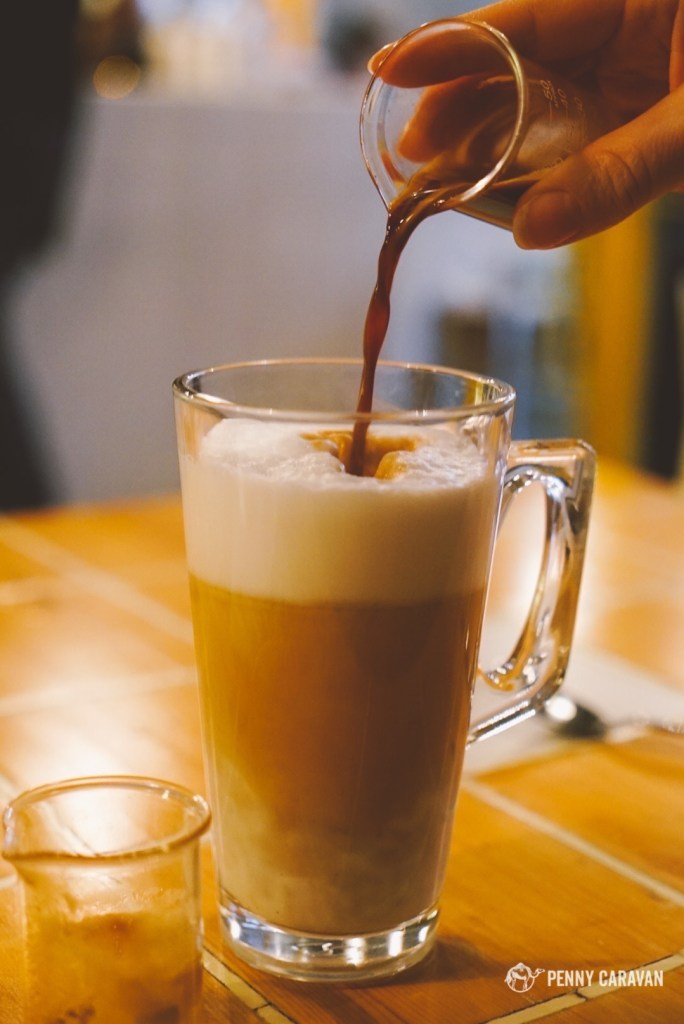 Iylana pouring her deconstructed latte.