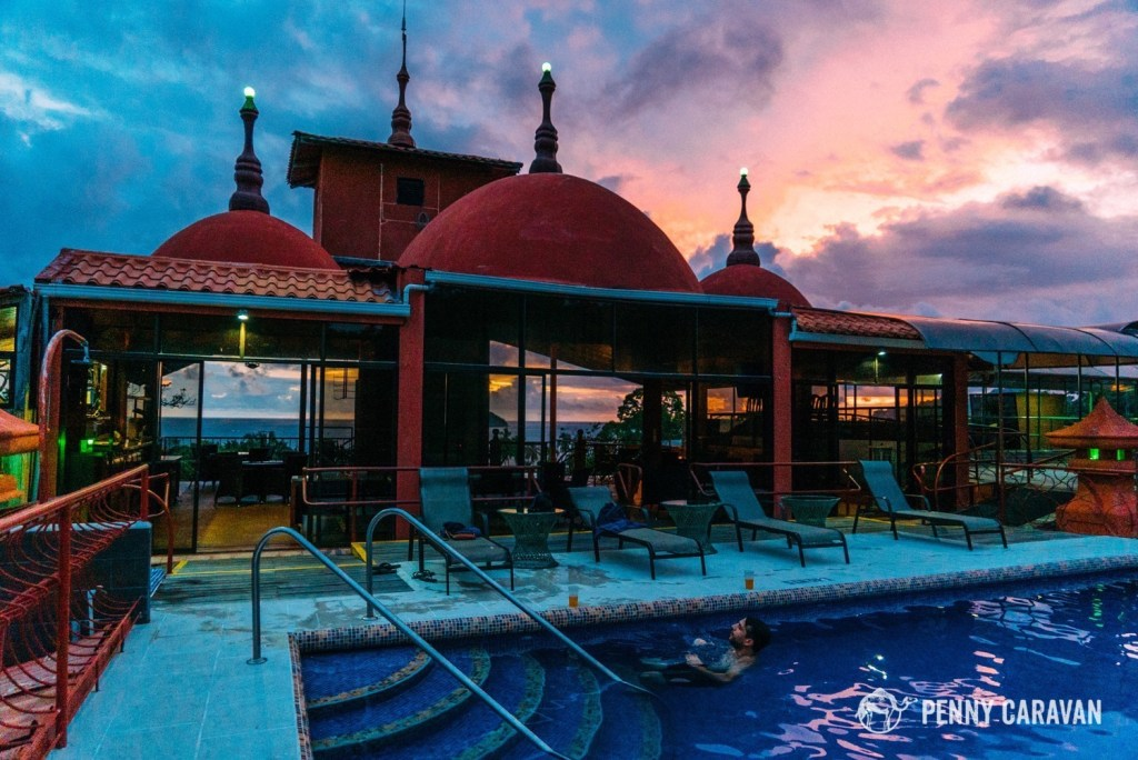 The rooftop pool at sunset. You can see the ocean in the background.