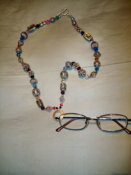 Eyeglass holder of sterling silver and multi colored crystals