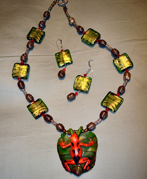 Hand carved Tagua nut frog with pearls and fused glass
