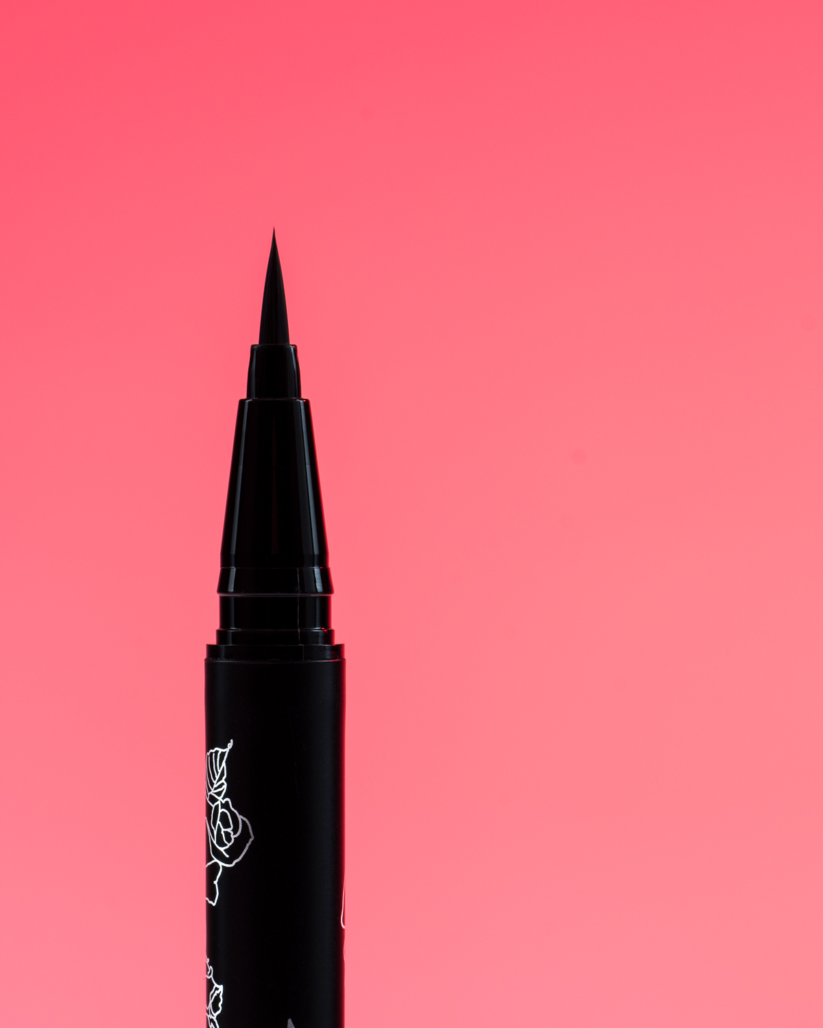 Kat Von D Beauty Tattoo Liner Trooper macro shot with a pink background