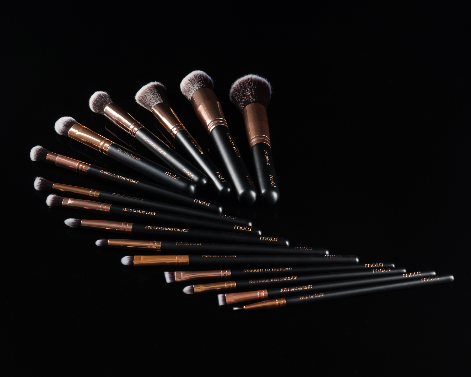M.O.T.D. Lux Vegan Brush Kit on a black background
