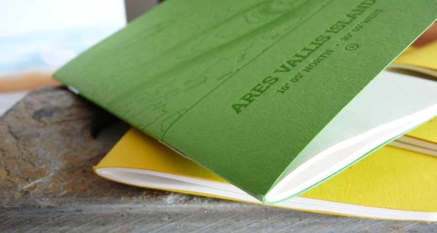 Analog LatLon notebook edge on