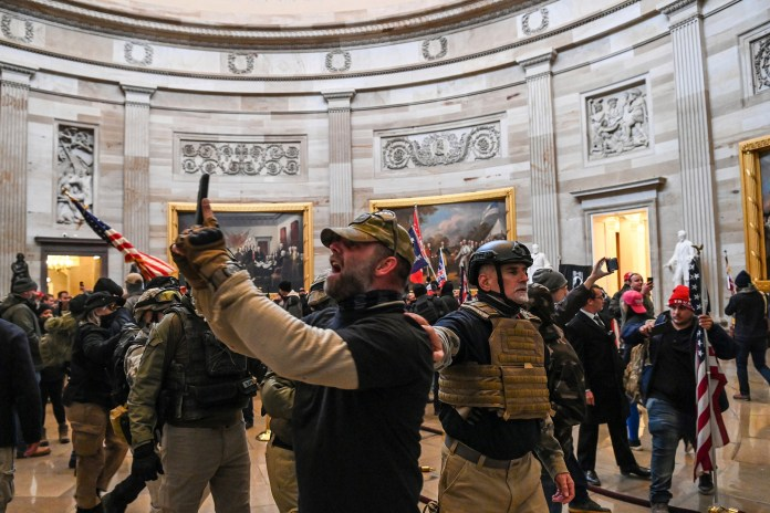 Protestors seen snapping pictures inside the Capitol building on Jan. 6, 2021.