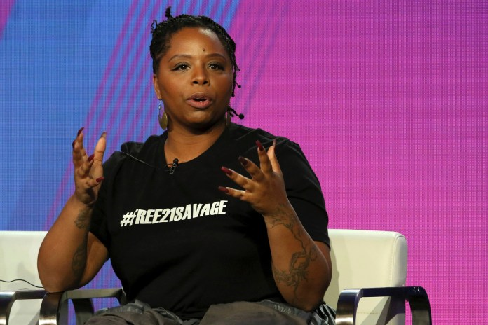 """Patrisse Cullors, Black Lives Matter co-founder, participates in the """"Finding Justice"""" panel during the BET presentation at the Television Critics Association Winter Press Tour at The Langham Huntington in Pasadena, Calif."""