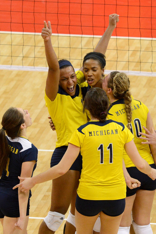 Molly Toon (center) in a volleyball game for the University of Michigan on November 30, 2012.