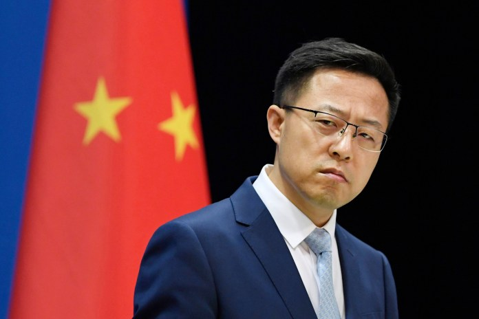 Chinese Foreign Ministry spokesman Zhao Lijian attends a press conference.