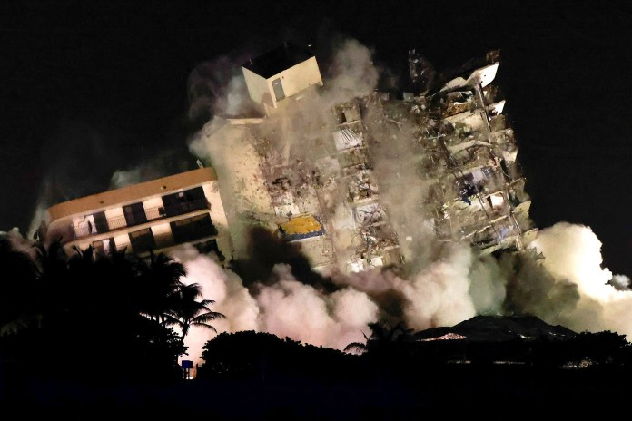 The partially collapsed Champlain Towers South residential building is demolished in Surfside, Florida,