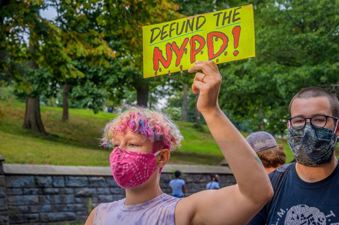 A protester call for the defunding of the NYPD during a demonstration in New York City.