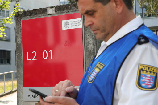 A policeman stands in front of the Technical University Darmstadt where a poisoning took place on Aug. 24, 2021.