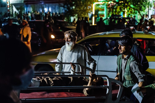 A wounded patient is brought by a taxi to Emergency Hospital in Kabul after the terrorist attack.